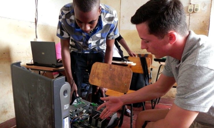 Cadet Dustin Stephans of Loyal University Chicago instructs on the components of computer systems at Kilimanjaro Information Technology in Moshi, Tanzania on 25 May 2016 in order to familiarize students with the capabilities and purpose of each component.