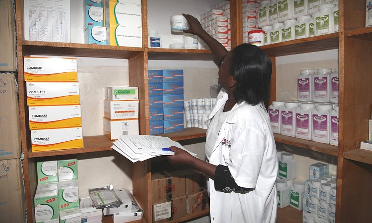 A health care worker conducts physical inventory in a health facility in Kinondoni District.