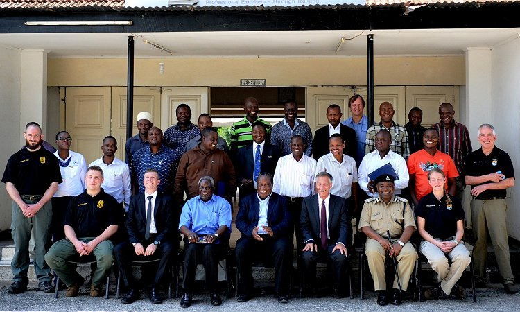 Amb. Mark Childress (front row, 3rd from right) with trainers and participants of the Wildlife Crime Scene Investigation Course. The Chief Guest Herman Keraryo - Director of Wildlife Division at MNRT (front row, 4th from right) closed the ceremony.