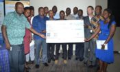 DLIIC 12 Winners receive a dummy cheque of 568 Million Tshs.